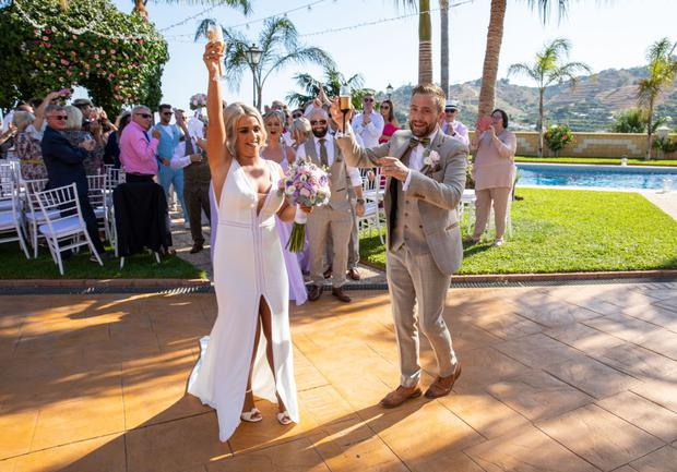George McMahon and Rachel Smyth with guests after their marriage in Nerja, southern Spain. PIC: Mark Beltran/Solarpix.com