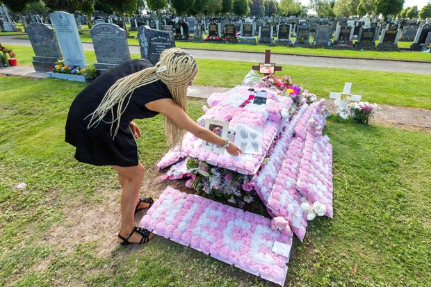 Bridget O'Donoghue at her daughter Santina Cawley's grave at St Catherines Cemetery in Kilcully, Co. Cork