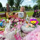 Bridget O'Donoghue tends to the grave of her two year old daughter, Santina Cawley