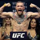 Conor McGregor stands on a scale during the weigh-in event for his fight against Eddie Alvarez in UFC 205 mixed martial arts, Friday, Nov. 11, 2016, at Madison Square Garden in New York. (AP Photo/Julio Cortez)
