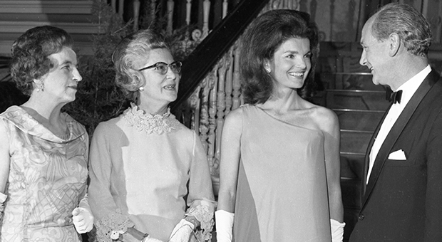 Taoiseach Jack Lynch entertains Jackie Kennedy at a reception at St. Patrick's Hall, Dublin Castle, on June 30th 1967. It was her first formal function since her arrival in Ireland. On the left are Máirín Lynch and Mrs. Frank Aiken.