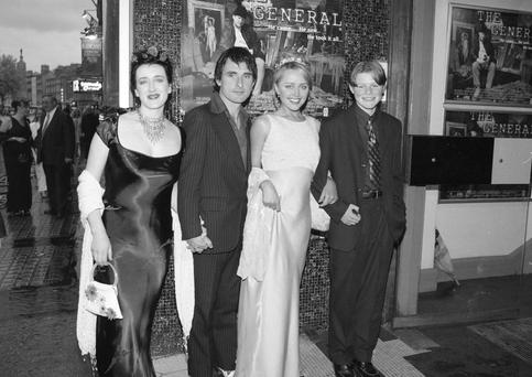No other decade did red carpet dressing quite like the nineties- we still aren't over Liz Hurley's safety pin dress. In 1998 Angeline Ball took to the red carpet with her co-stars from the film The General, wearing a tiara you almost certainly also wore to your debs that year.