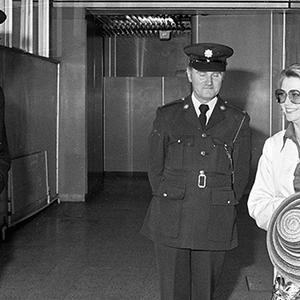 Grace Kelly arrives at Dublin Airport accompanied by Lord Killanin, Honorary Consul of Monaco, for a four-day trip to Ireland.