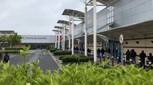 Shoppers queue at Blanchardstown shopping centre (Aine McMahon/PA)