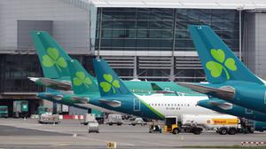 Aer Lingus jets parked up on the runway of Dublin airport (Niall Carson/PA)