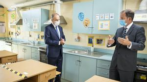 Taoiseach Micheal Martin, left, with principal Jim O'Sullivan visiting Nagle Secondary Community College in Cork (Julien Behal)