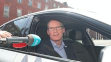 Reporters direct questions to Simon Coveney (Niall Carson/PA)