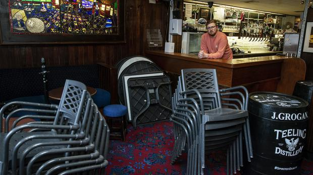 Daniel Smith, bartender and son of one of the co-owners of Grogan's Castle Lounge, at the premises in Dublin city centre (Brian Lawless/PA)
