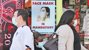 People wearing face coverings in Athy, Co Kildare. Photo: Niall Carson/PA