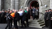 The coffin of Captain Mark Duffy is carried from St Oliver Plunkett Church