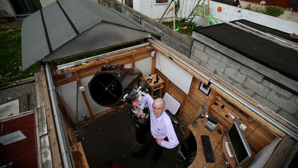 Amateur astronomer Dave Grennan with the telescope he built himself in a shed in his Dublin back garden that has a retractable roof