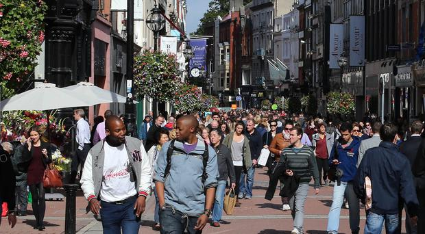 Shoppers on Dublin's Grafton Street. Ireland's economy has picked up momentum, according the Moody's