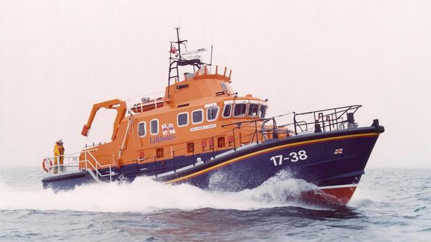 An RNLI lifeboat crew helped rescue a fisherman from the sea off Ireland