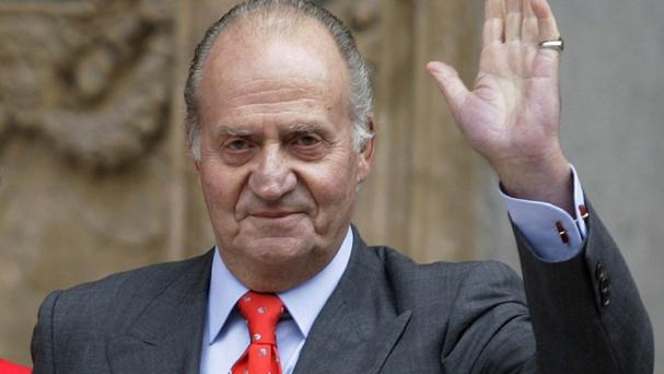 King Juan Carlos is to abdicate and pave the way for his son, Crown Prince Felipe (AP)