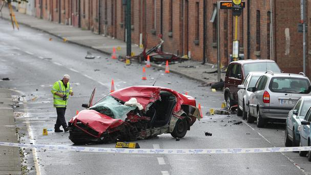 The scene in the James's Street area of Dublin after a man travelling in a stolen taxi died when it struck a pole