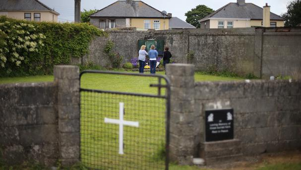 Members of the public at the mass grave in Tuam.