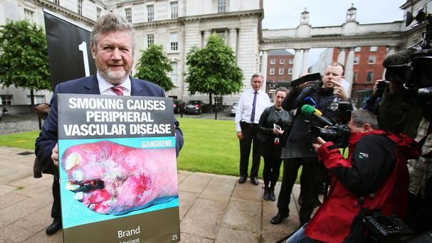 Minister for Health James Reilly speaking to media at Government Buildings, Dublin, as Ireland has become the first European country to order a ban on branded cigarette packets