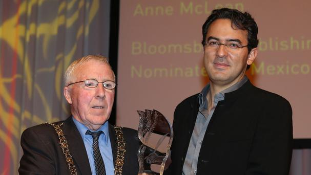 Lord Mayor of Dublin Christie Burke, left, presents Juan Gabriel Vasquez with the International IMPAC Dublin literary award