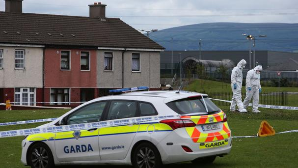 Members of the Garda forensic team at the crime scene in Croftwood Gardens, Dublin, where a six-year-old boy was shot