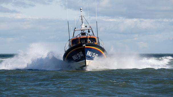 An injured man was put into a stretcher and removed from rocks into a lifeboat in one of three weekend accidents, two of them fatal