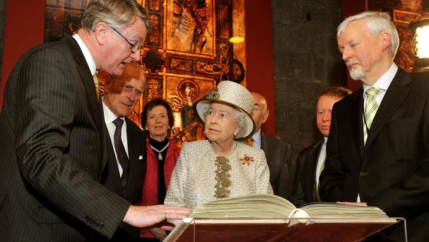 The manuscripts will go on display alongside the Book of Kells, here being viewed by the Queen