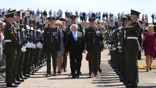 President Michael D Higgins is given a Guard of Honour during a ceremony to commemorate a century since the landing of arms at Howth east pier