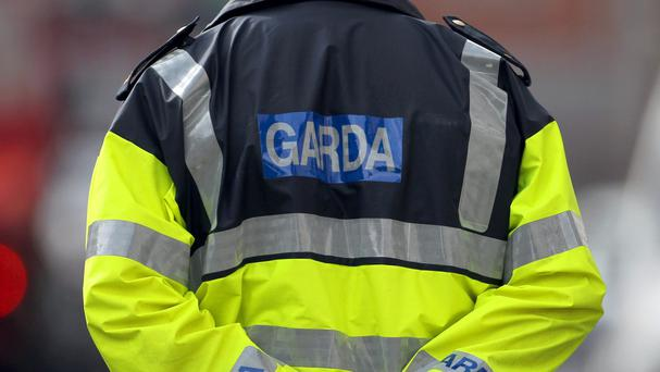 A garda is recovering today after he was struck by a stolen car in Dublin on a busy city street.