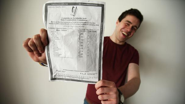 St Michael's College student Conor Gallagher with his Leaving Certificate results of nine higher level A1s