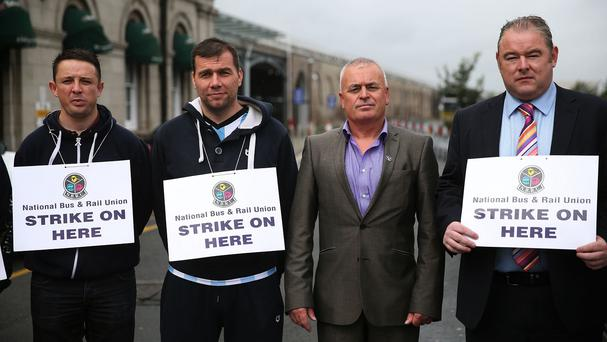 General secretary of the National Bus and Rail Union Dermot O'Leary with strikers outside Heuston rail station in Dublin