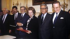 Margaret Thatcher shakes hands with Dr Garret Fitzgerald