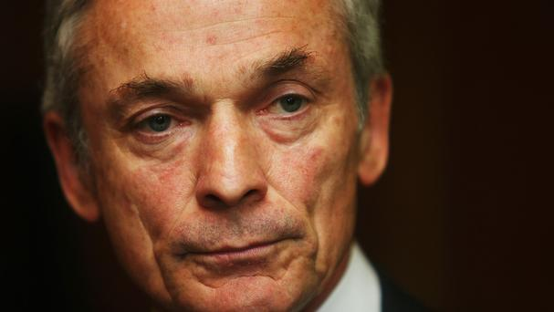 Employment Minister Richard Bruton has announced 100 new jobs at a customer centre in Dundalk