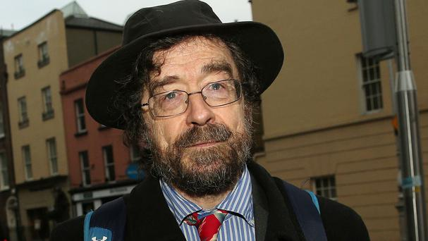 Professor John FitzGerald arrives at Leinster House to give evidence before the Oireachtas Banking Inquiry