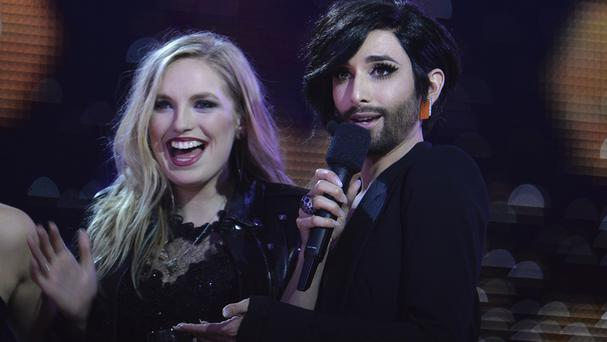 Molly Sterling representing Ireland, left, and Conchita Wurst watch the second semifinal of the Eurovision Song Contest (AP)