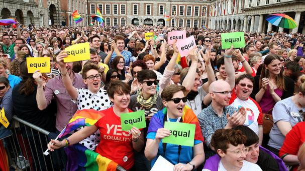 Crowds celebrate at Dublin Castle after the marriage referendum was passed last Saturday.
