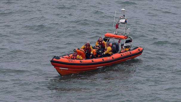 Veteran RNLI official, Kieran Cotter, struggled to find words for the triple tragedy which turned a hazy late June evening in the idyllic west Cork village into one of the worst tragedies ever experienced locally