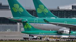 Aer Lingus blamed fluctuations in foreign exchange rates and high fuel prices for its drop in profits