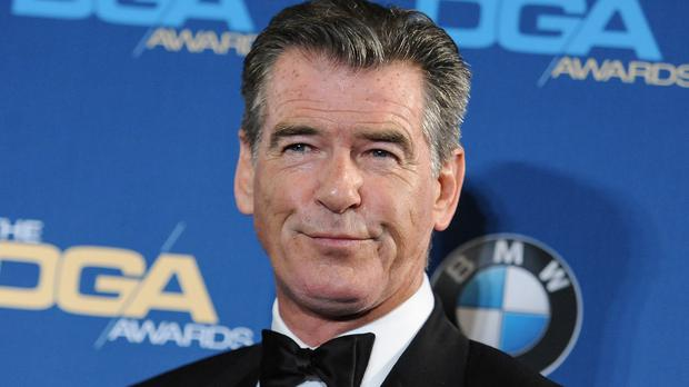 Pierce Brosnan was stopped with a knife in his hand luggage (AP)