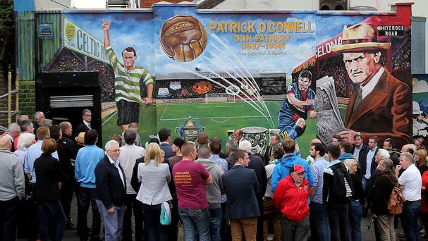Crowds gather as a new mural is unveiled in Belfast to mark the life of footballer Patrick O'Connell, whose career saw him play for Belfast Celtic and Manchester United and manage Barcelona.