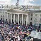 Protestors outside the General Post Office during a demonstration against water charges in Dublin, organised by the Right2Water campaign which includes community groups, trade unions and political representatives