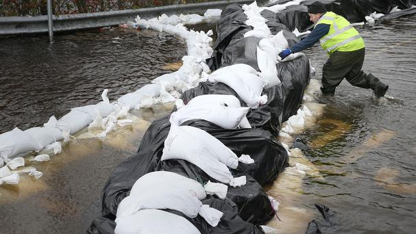 Local Councillor Kevin Moran helps with flood defences in the town Athlone, by the river Shannon