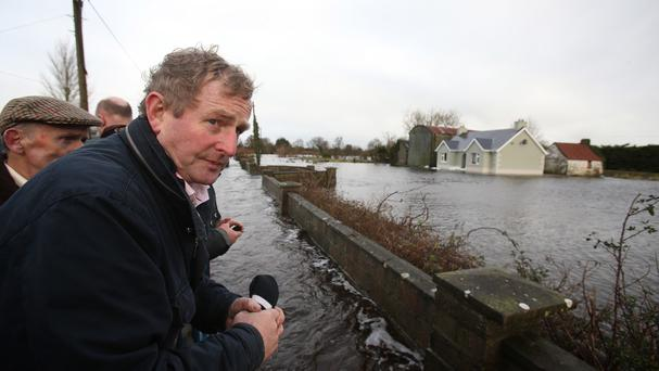 Taoiseach Enda Kenny as he tours the area of Carrick-On-Shannon following flooding. Photo: PA