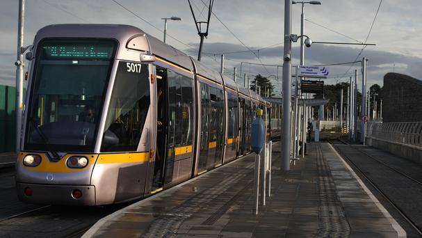 Up to 90,000 Luas passengers face chaos and retailers predict losses of €1m a day after industrial action began last night. Photo: Niall Carson/PA Wire
