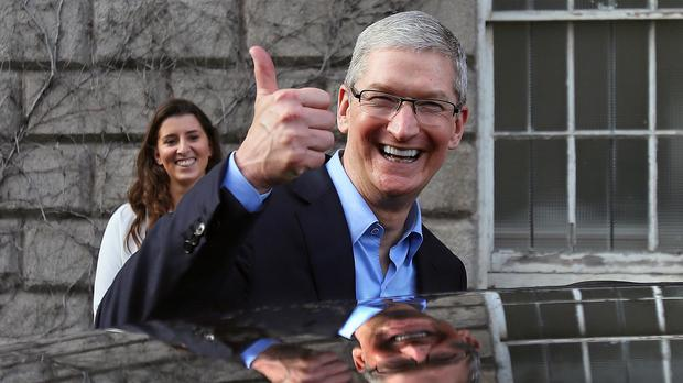 Apple chief executive Tim Cook leaving Trinity College in Dublin.