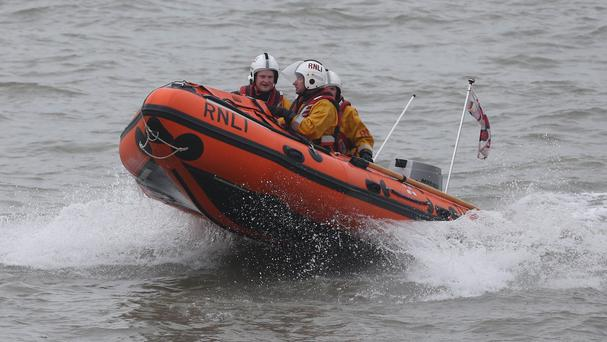 A spokesman for Dun Laoghaire Lifeboat said the two women were a half-mile offshore when they noticed the tide rising around them. Photo: PA