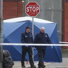 Gardai at the scene of a fatal shooting outside the Noctor's pub in Dublin's Sheriff Street