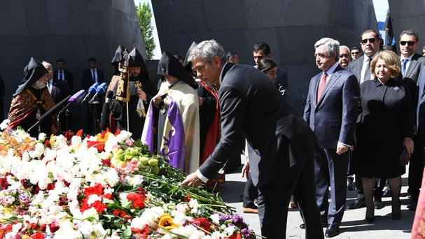 George Clooney takes part in a remembrance service at the Armenian Genocide memorial in Yerevan