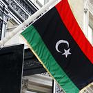 The flag of the Libyan Republic used by the National Transitional Council outside the Libyan Embassy in London.