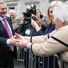 Newly elected Taoiseach Enda Kenny greets supporters in Dublin