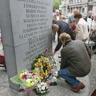 Relatives lay wreaths at the memorial to the victims of the 1974 Dublin Monaghan Bombings in Dublin