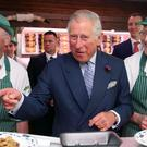 The Prince of Wales sampled award-winning sausages made by brothers Diarmuid (left) and Ernan McGettigan at McGettigan's butcher's shop in Donegal town